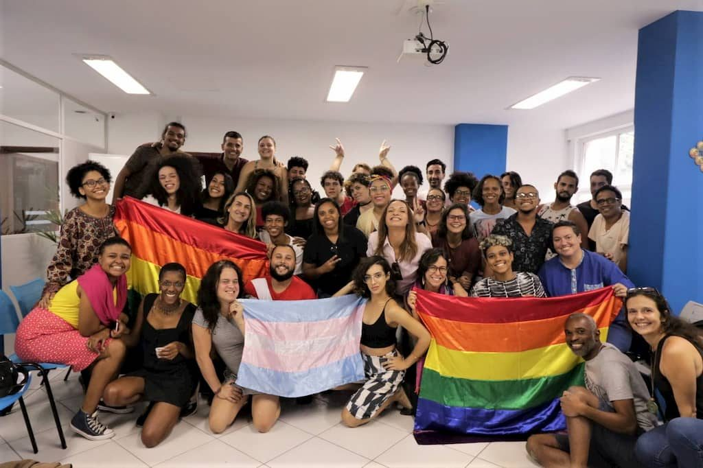 Students from the 6th course posing with rainbow and trans flags
