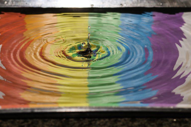 Rainbow drop in water